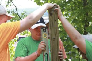 Rainelle — Along with a half-dozen enthusiastic local volunteers, a troop of Pennsylvania Boy Scouts tackled tasks from tombstone cleaning to fence building at the Rainelle Cemetery, as part of the National Scout Jamboree now under way at the Summit Bechtel Reserve in Fayette County.