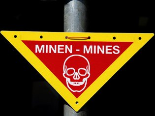 77442266_800pxMines_warning_sign.jpg