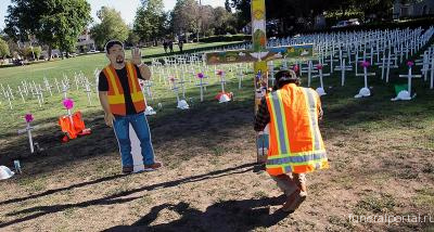 '600 Crosses' Honor Immigrant Essential Workers Who Died During Pandemic
